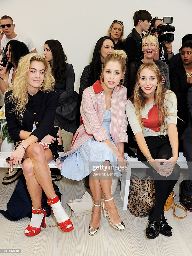 Chelsea Leyland, Peaches Geldof and Harley Viera-Newton attend the Vivienne Westwood Red Label show during London Fashion Week Fall/Winter 2013/14 at the Saatchi Gallery on February 17, 2013 in London, England.