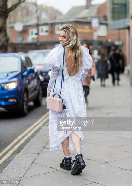 Chelsea Leyland wearing a white laced dress outside Chalayan on day 2 of the London Fashion Week February 2017 collections on February 18 2017 in...