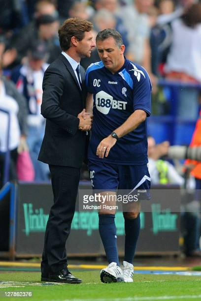 Chelsea manager Andre Villas Boas shakes hands with dejected Bolton manager Owen Coyle after the Barclays Premier League match between Bolton...