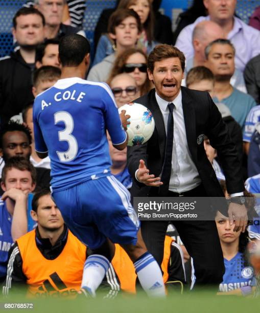 Chelsea Manager Andre VillasBoas throws the ball to Ashley Cole of Chelsea during the Barclays Premier League match between Chelsea and Swansea City...