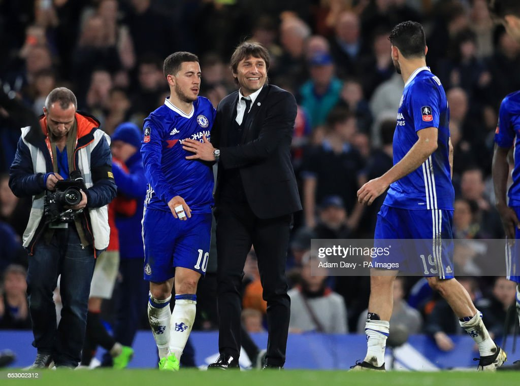 Chelsea manager Antonio Conte and Eden Hazard celebrate at full time during the Emirates FA Cup, Quarter Final match at Stamford Bridge, London.