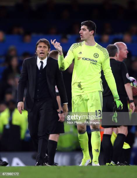 Chelsea manager Antonio Conte and goalkeeper Thibaut Courtois after during the Premier League match at Stamford Bridge London