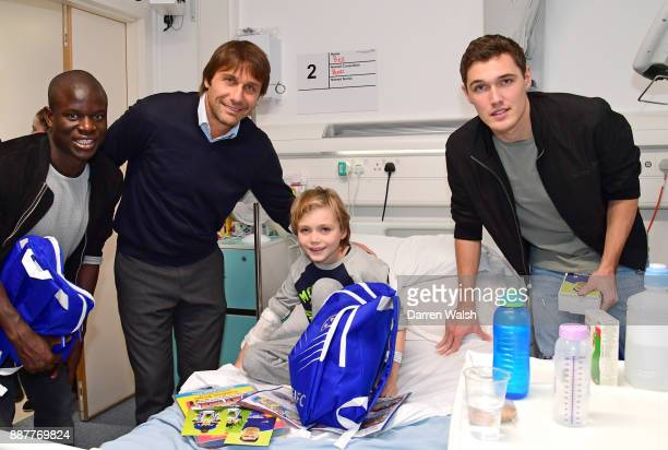 Chelsea Manager Antonio Conte and N'golo Kante and Andreas Christensen of Chelsea with Ben Sharky at the Hospital on December 7 2017 in London England