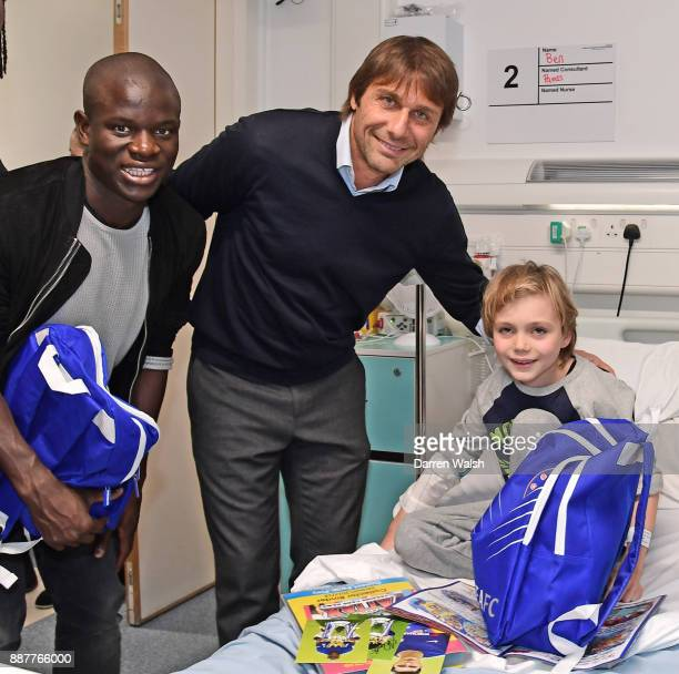 Chelsea Manager Antonio Conte and N'golo Kante of Chelsea with Ben Sharky at the Hospital on December 7 2017 in London England
