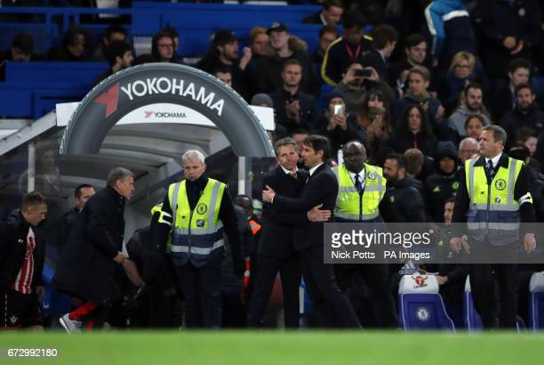 Chelsea manager Antonio Conte and Southampton manager Claude Puel embrace at the final whistle of the Premier League match at Stamford Bridge London