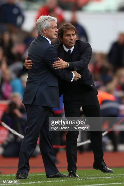 Chelsea manager Antonio Conte and Stoke City manager Mark Hughes on the final whistle during the Premier League match at the bet365 Stadium...