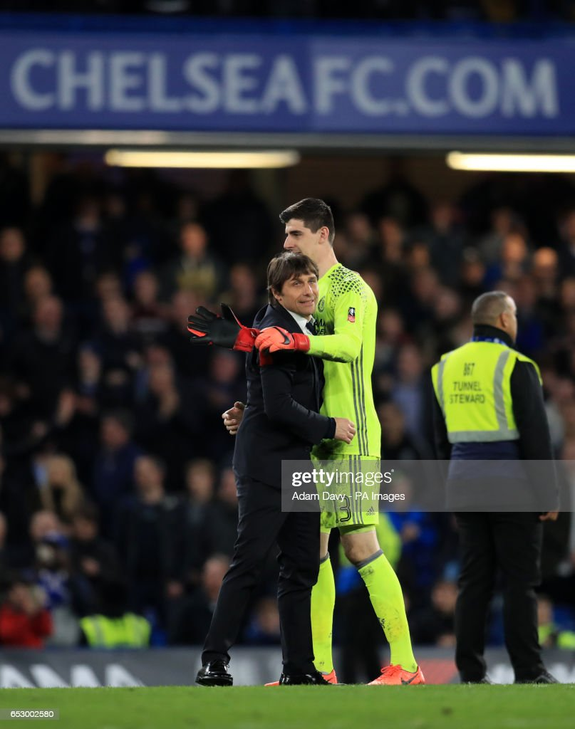 Chelsea manager Antonio Conte and Thibaut Courtois celebrate at full time during the Emirates FA Cup, Quarter Final match at Stamford Bridge, London.