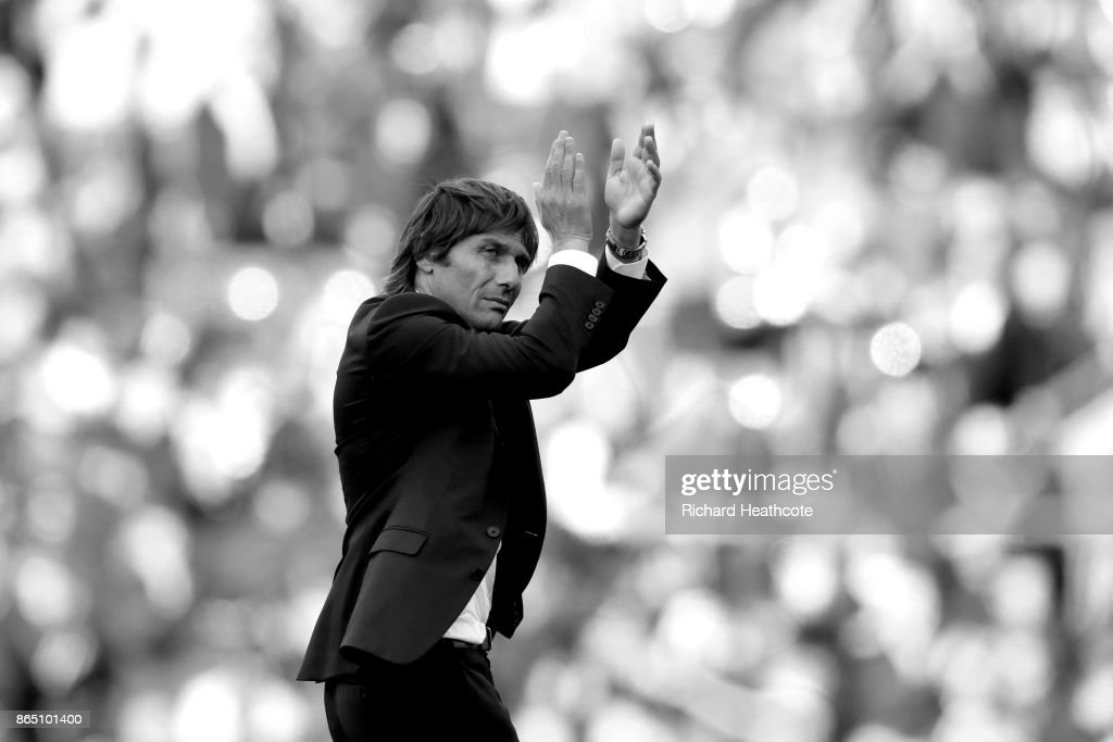 Chelsea manager Antonio Conte applaudes the crowd a the final whistle during the Premier League match between Chelsea and Watford at Stamford Bridge on October 21, 2017 in London, England.
