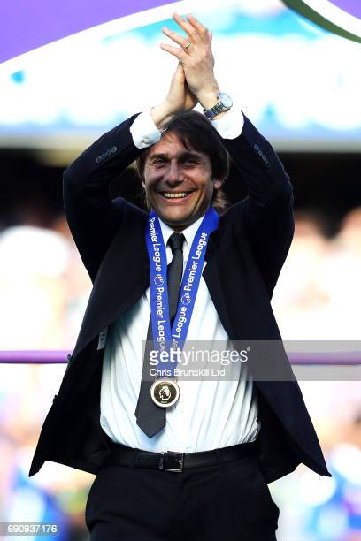 Chelsea manager Antonio Conte applauds the supporters following the Premier League match between Chelsea and Sunderland at Stamford Bridge on May 21...