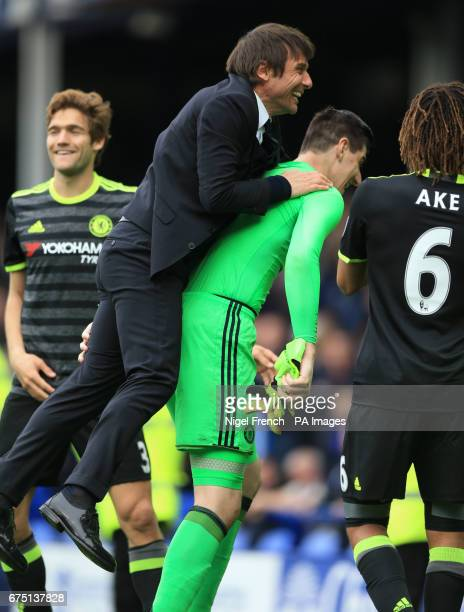 Chelsea manager Antonio Conte celebrates victory with Thibaut Courtois after the Premier League match at Goodison Park Liverpool