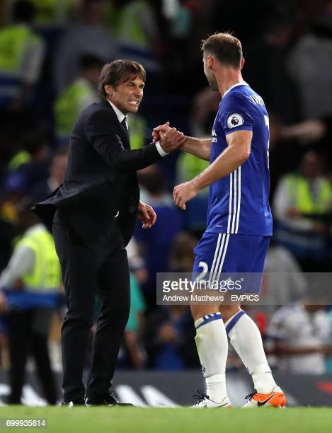 Chelsea manager Antonio Conte celebrates with Branislav Ivanovic after the final whistle