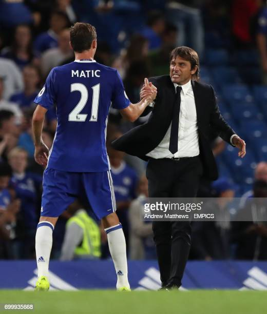 Chelsea manager Antonio Conte celebrates with Nemanja Matic after the final whistle
