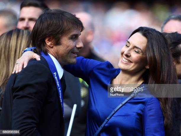 Chelsea manager Antonio Conte celebrates with wife during the Premier League match between Chelsea and Sunderland at Stamford Bridge London England...