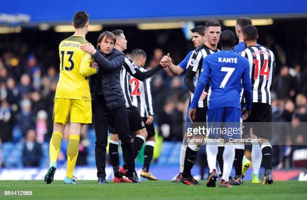 Chelsea manager Antonio Conte congratulates Thibaut Courtois after the Premier League match between Chelsea and Newcastle United at Stamford Bridge...