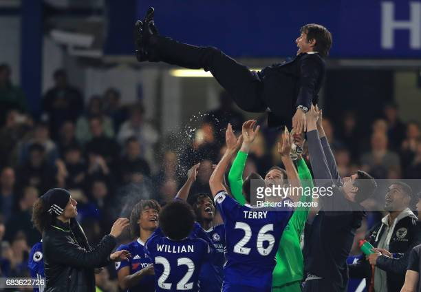 Chelsea manager Antonio Conte is thrown in the air during post match celebrations after the Premier League match between Chelsea and Watford at...