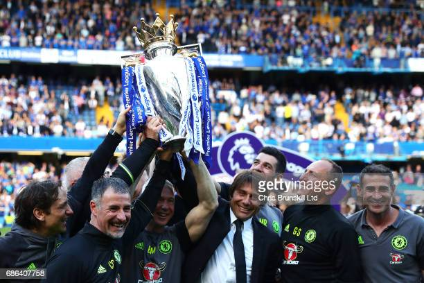 Chelsea manager Antonio Conte lifts the Premier League trophy with his coaching staff following the Premier League match between Chelsea and...