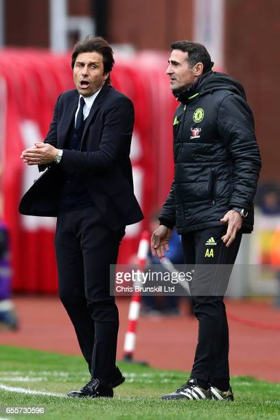 Chelsea manager Antonio Conte looks on next to assistant Angelo Alessio during the Premier League match between Stoke City and Chelsea at Bet365...