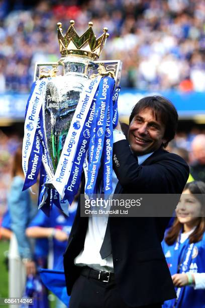 Chelsea manager Antonio Conte poses with the Premier League trophy following the Premier League match between Chelsea and Sunderland at Stamford...