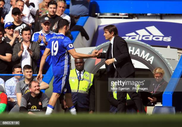 Chelsea manager Antonio Conte shakes hands with Diego Costa during the Premier League match at Stamford Bridge London