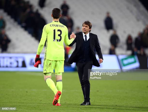 Chelsea manager Antonio Conte shanks hands with Chelsea's Thibaut Courtois during the prematch warmup during EPL Premier League match between West...