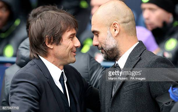 Chelsea manager Antonio Conte with Manchester City manager Pep Guardiola before kickoff during the Premier League match at the Etihad Stadium...