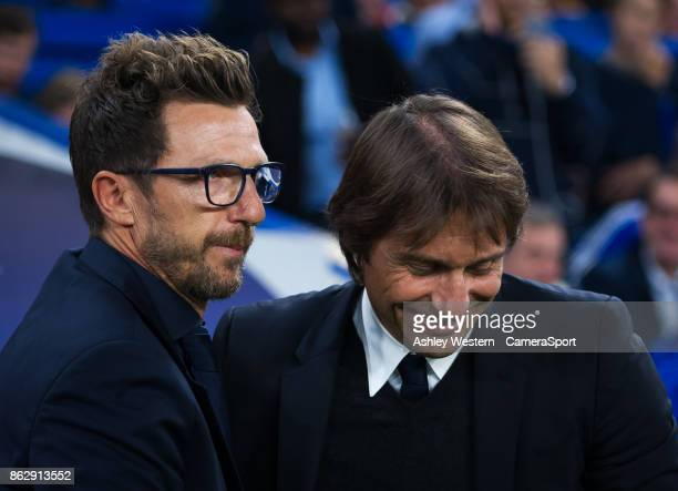 Chelsea manager Antonio Conte with Roma manager Eusebio Di Francesco before the UEFA Champions League group C match between Chelsea FC and AS Roma at...