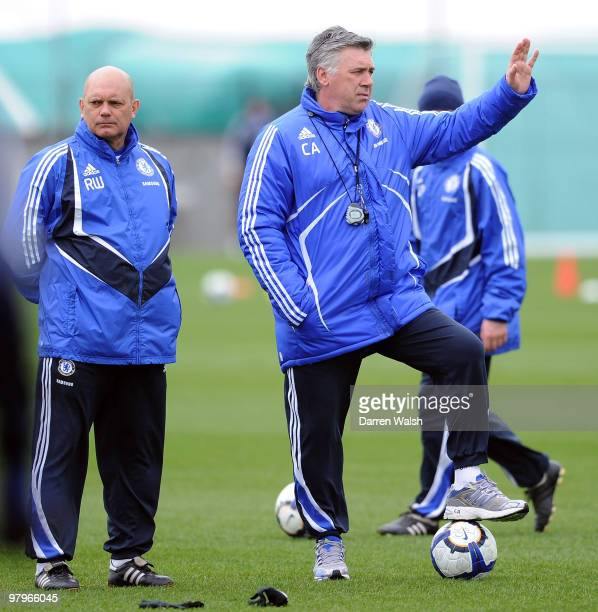 Chelsea manager Carlo Ancelotti and Ray Wilkins during a training session at the Cobham training ground on March 23 2010 in Cobham England