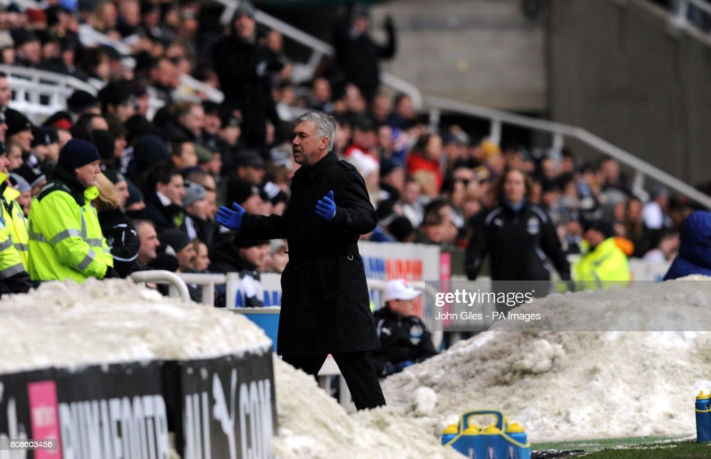 Chelsea manager Carlo Ancelotti gestures on the touchline near piles of snow during the Barclays Premier League match at St James' Park, Newcastle.