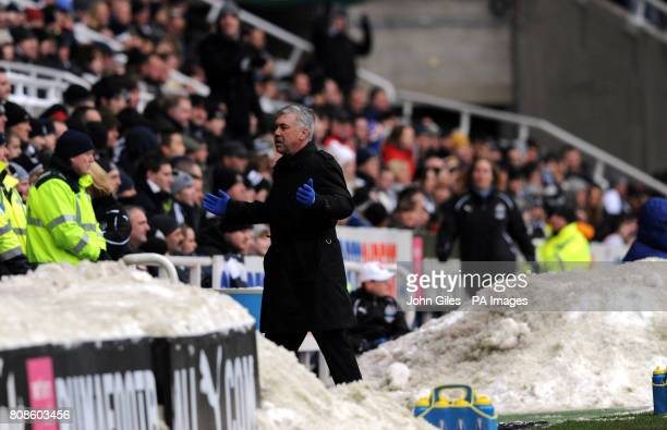 Chelsea manager Carlo Ancelotti gestures on the touchline near piles of snow during the Barclays Premier League match at St James' Park Newcastle