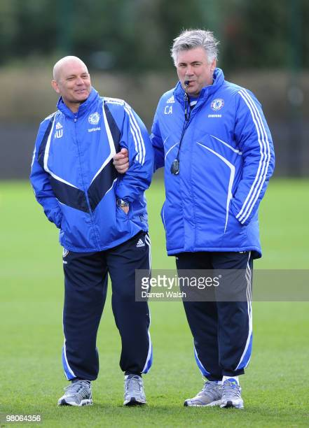 Chelsea manager Carlo Ancelotti helps his injured Assistant Ray Wilkins during a training session at the Cobham training ground on March 26 2010 in...
