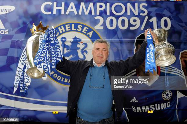 Chelsea Manager Carlo Ancelotti poses with the Premier League and FA Cup trophies prior to the Chelsea Football Club Victory Parade on May 16 2010 in...