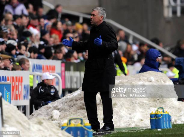 Chelsea manager Carlo Ancelotti reacts near piles of snow on the touchline during the Barclays Premier League match at St James' Park Newcastle