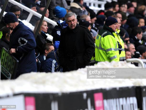 Chelsea manager Carlo Ancelotti stands near piles of snow on the touchline during the Barclays Premier League match at St James' Park Newcastle