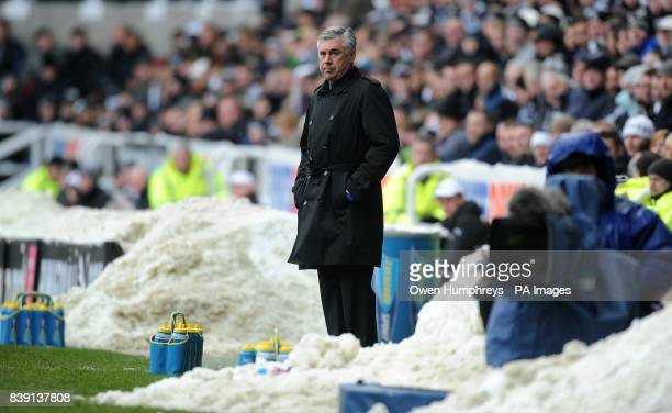 Chelsea manager Carlo Ancelotti watches the action from a snow covered touchline