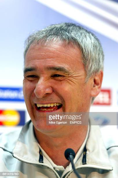 Chelsea manager Claudio Ranieri shares a joke with members of the press