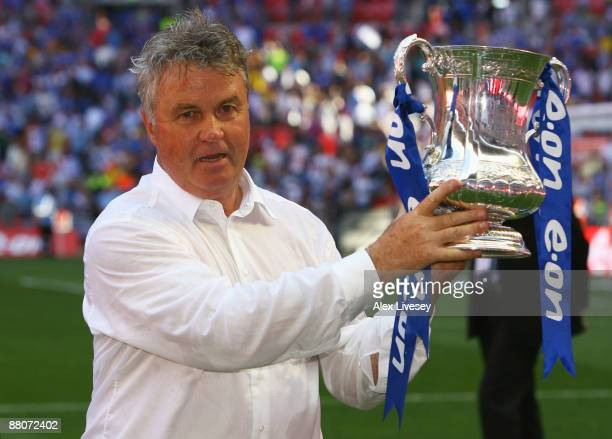 Chelsea Manager Guus Hiddink lifts the trophy after the FA Cup sponsored by EON Final match between Chelsea and Everton at Wembley Stadium on May 30...
