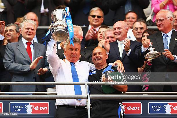 Chelsea manager Guus Hiddink lifts the trophy assistant Ray Wilkins following victory during the FA Cup sponsored by EON Final match between Chelsea...