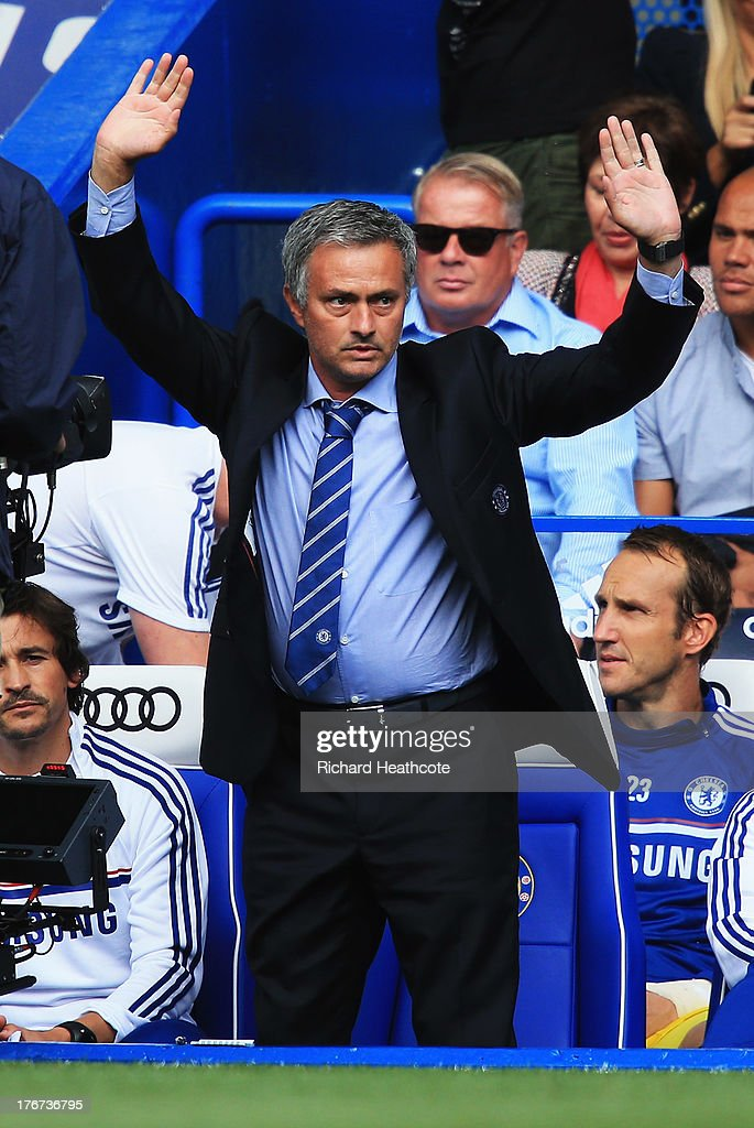 Chelsea manager Jose Mourinho acknowledges the fans during the Barclays Premier League match between Chelsea and Hull City at Stamford Bridge on August 18, 2013 in London, England.
