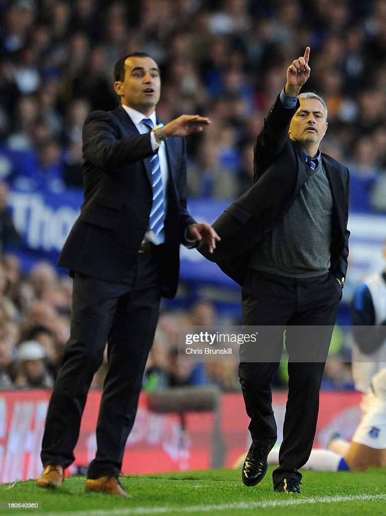 Chelsea Manager Jose Mourinho and Everton Manager Roberto Martinez (L) react during the Barclays Premier League match between Everton and Chelsea at Goodison Park on September 14, 2013 in Liverpool, England.