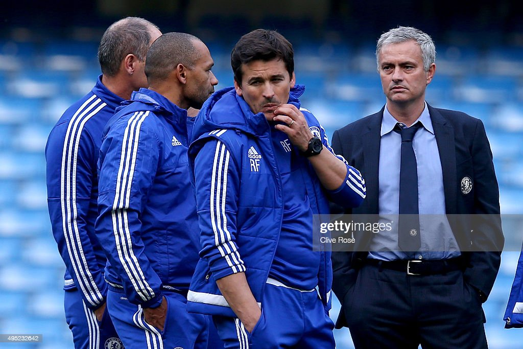 Chelsea manager Jose Mourinho and his staffs discuss on the pitch after their team's 1-3 defeat in the Barclays Premier League match between Chelsea and Liverpool at Stamford Bridge on October 31, 2015 in London, England.