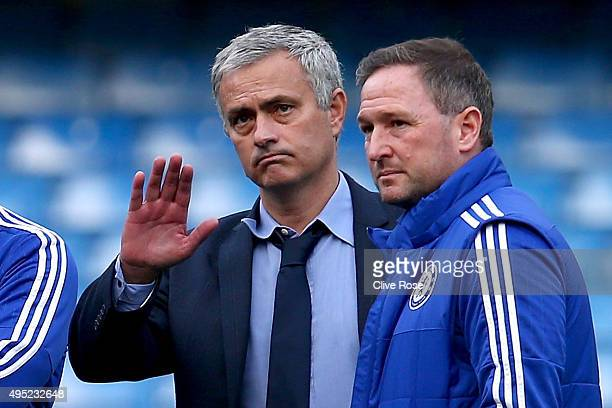 Chelsea manager Jose Mourinho and his staffs discuss on the pitch after their team's 13 defeat in the Barclays Premier League match between Chelsea...