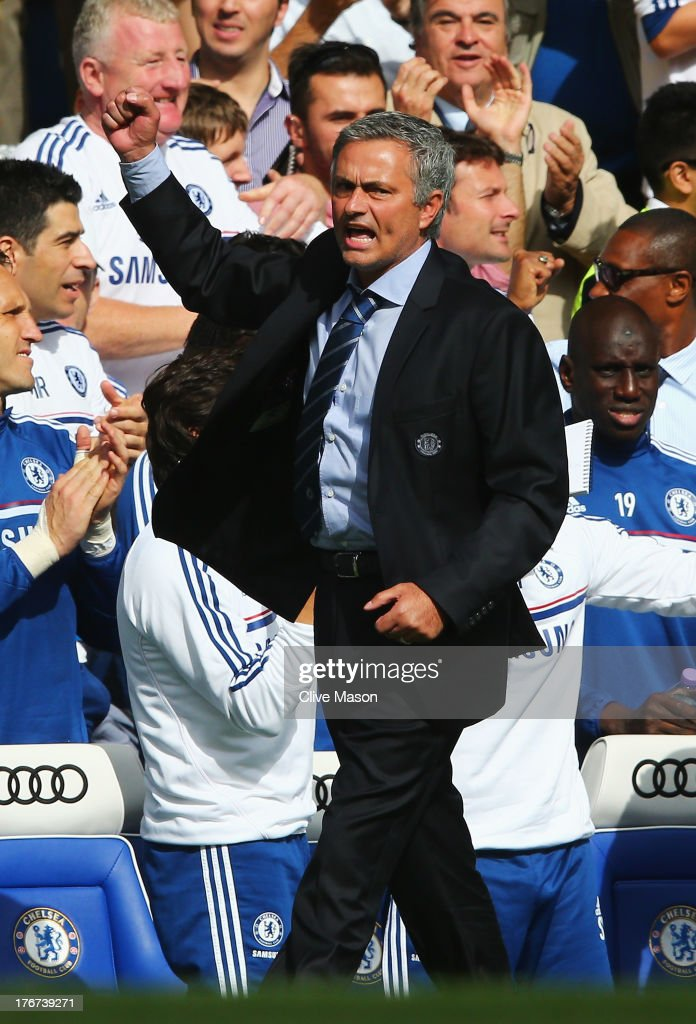Chelsea manager Jose Mourinho celebrates the opening goal scored by Oscar of Chelsea during the Barclays Premier League match between Chelsea and Hull City at Stamford Bridge on August 18, 2013 in London, England.