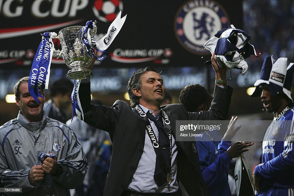 Chelsea Manager Jose Mourinho celebrates with the trophy following his team's victory at the end of the Carling Cup Final match between Chelsea and...