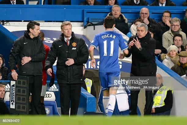 Chelsea manager Jose Mourinho gives instruction to Emboaba Oscar as Manchester United manager David Moyes looks on