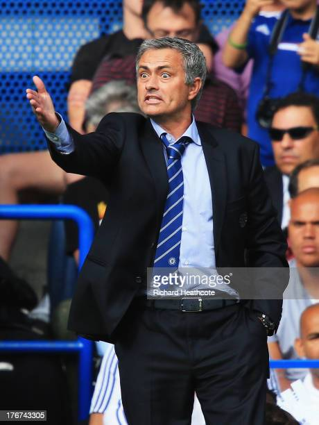 Chelsea manager Jose Mourinho gives instructions during the Barclays Premier League match between Chelsea and Hull City at Stamford Bridge on August...
