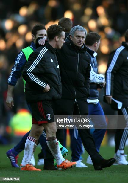 Chelsea manager Jose Mourinho has a word with former Chelsea player and now Fulham's Scott Parker as they walk off at the end of the Barclays Premier...