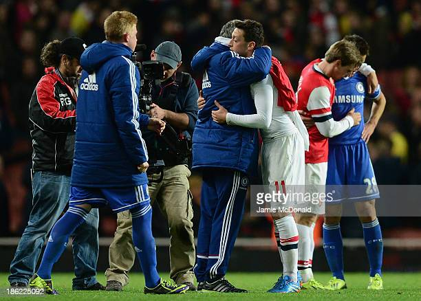 Chelsea manager Jose Mourinho hugs Mesut Ozil of Arsenal after the final whistle during the Capital One Cup Fourth Round match between Arsenal and...