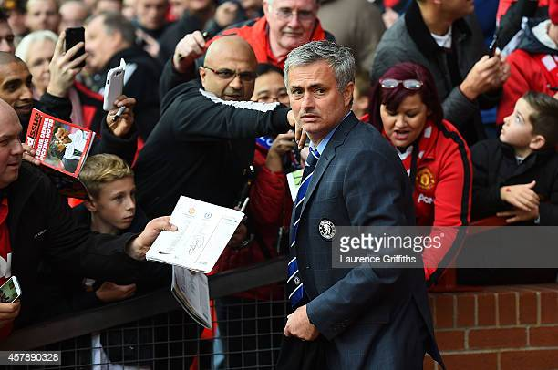 Chelsea Manager Jose Mourinho is asked for his autograph by fans prior to the Barclays Premier League match between Manchester United and Chelsea at...