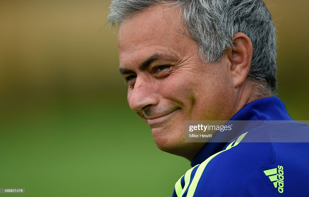 Chelsea manager Jose Mourinho jokes with the media during a Chelsea training session at the Chelsea training ground on September 16 2014 in Cobham...
