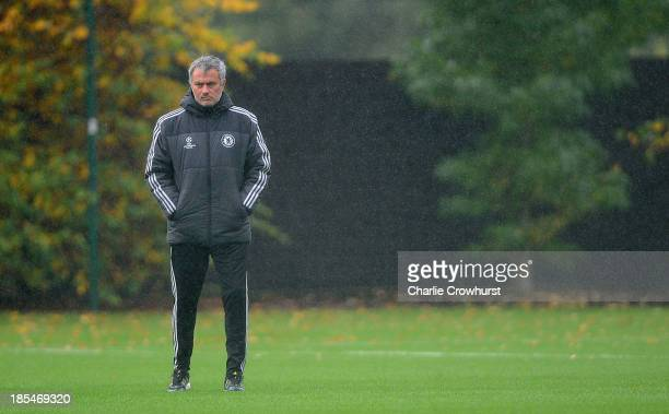 Chelsea manager Jose Mourinho keeps an eye on the warm up during a Chelsea training session ahead of their UEFA Champions League Group E match...